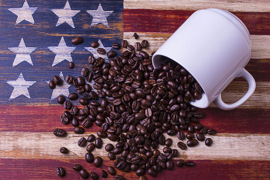 coffee cup on american flag photograph by garry gay