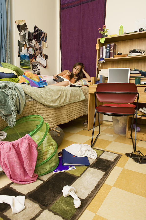 College Student Studying In Messy Dorm Room Photograph by Yellow Dog Productions