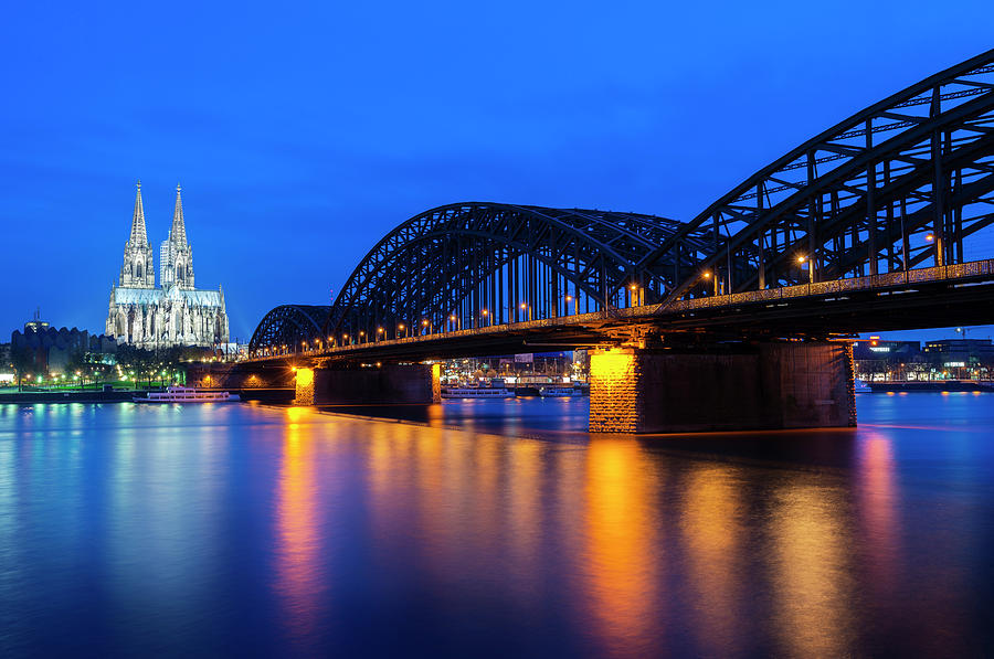 Cologne Cathedral And The Hohenzollern Photograph by Deejpilot
