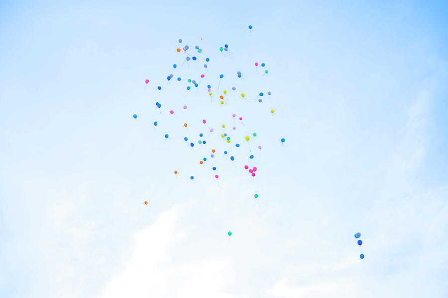 Colorful Balloons Flying Away In Blue Photograph by Malorny