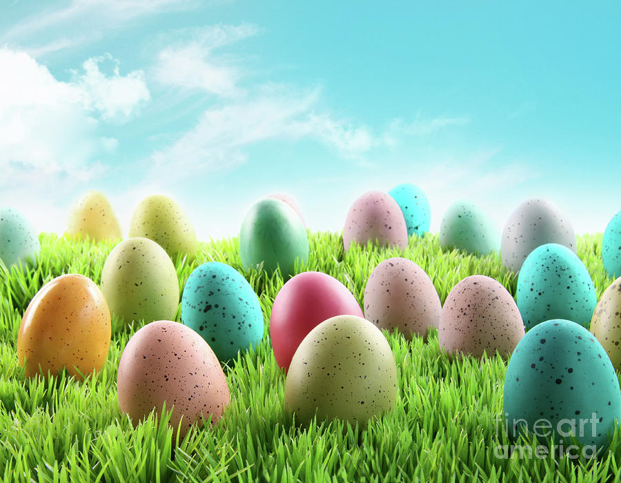 April Photograph - Colorful Easter Eggs In A Field Of Grass by Sandra Cunningham
