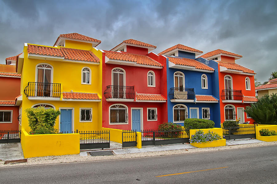 Colorful houses in the dominican republic photograph by for Big houses in america