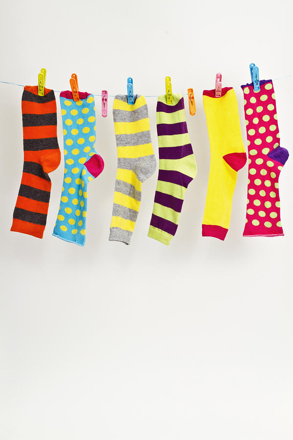 Colorful socks on washing line Photograph by Image by Catherine MacBride