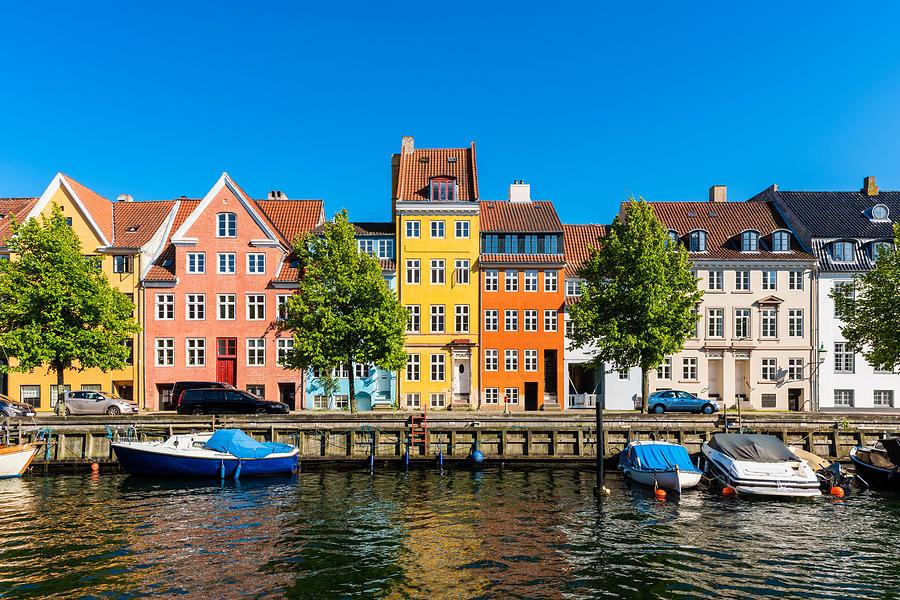 Colourful houses along canal in Copenhagen Denmark Photograph by © Allard Schager