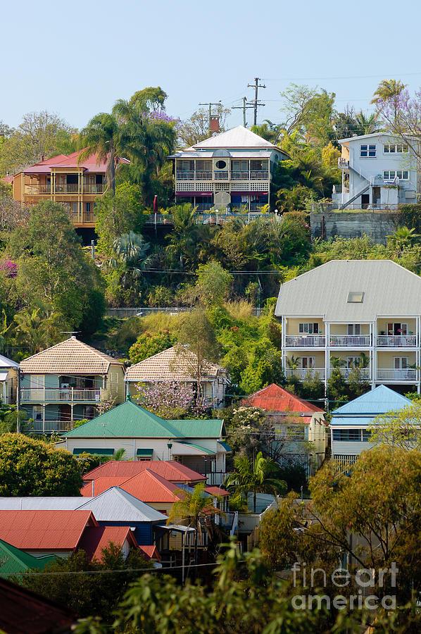 Queenslander Photograph - Colourful Queenslander Houses On A Steep Hillside  by David Hill