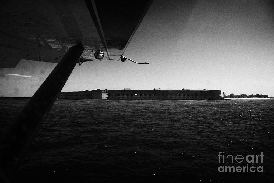 Coming Photograph - Coming In To Land On The Water In A Seaplane Next To Fort Jefferson Garden Key Dry Tortugas Florida  by Joe Fox