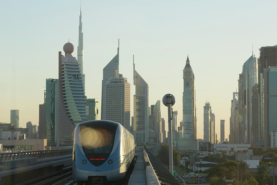 Commuter Train Speeds Towards Financial Photograph by Ascent Xmedia