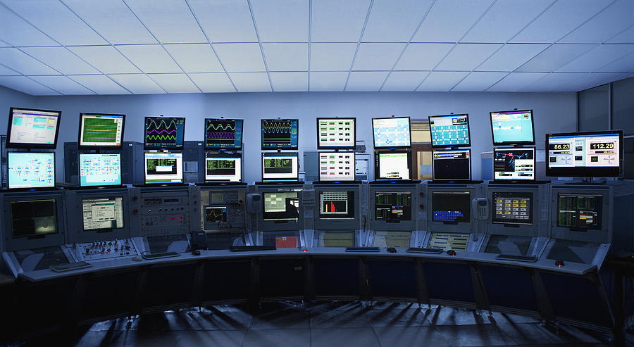 Computer screens in control room Photograph by Martin Barraud