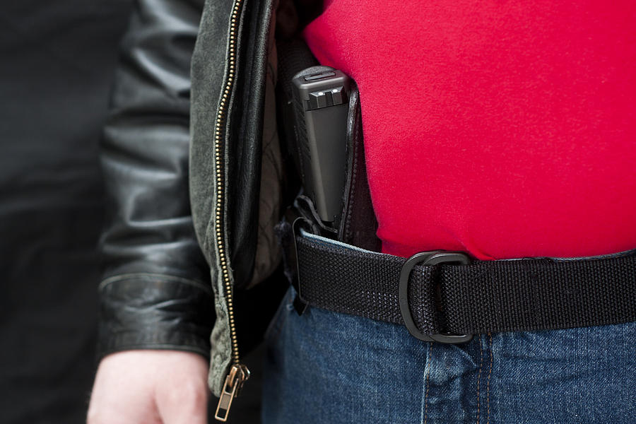 Concealed Firearm Under Jacket Photograph by RonBailey
