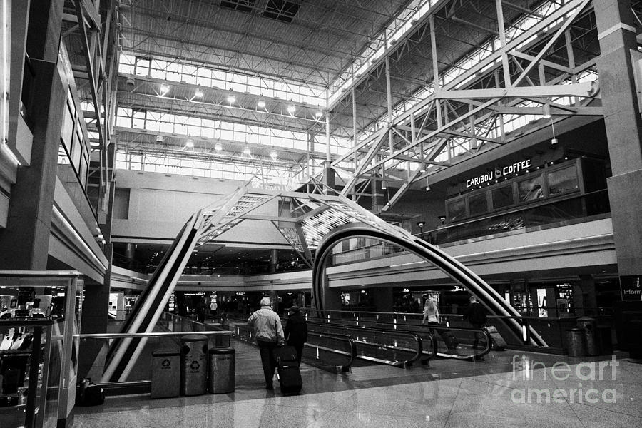 Departures Photograph - concourse B at Denver International Airport Colorado USA by Joe Fox