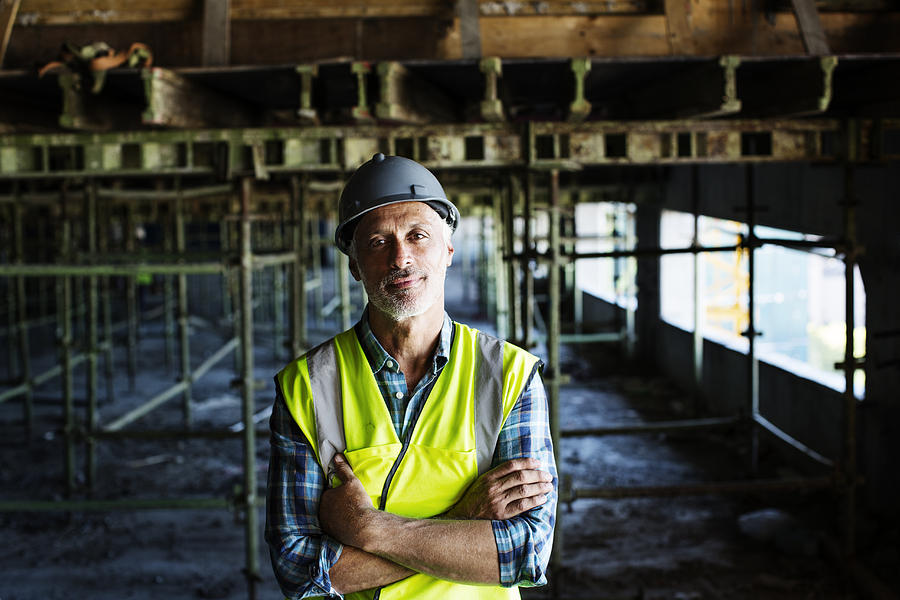 Confident Architect Standing At Construction Site Photograph by Morsa Images