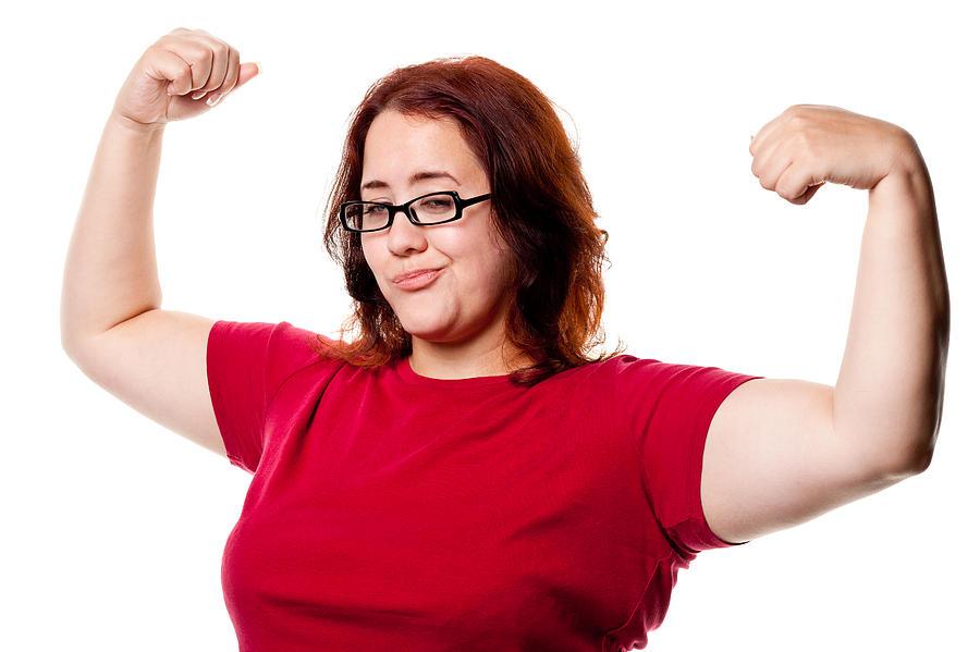 Confident Woman Shows Off Arms Photograph by Drbimages