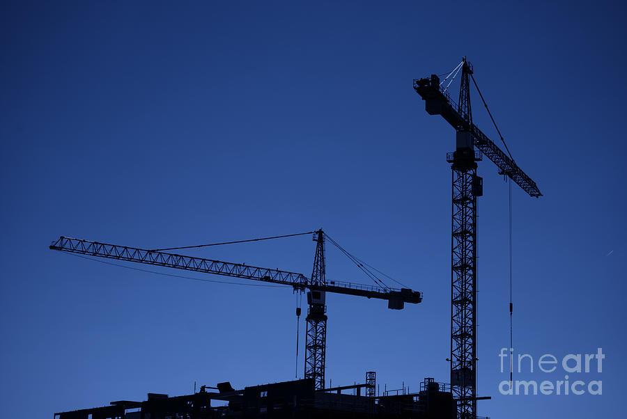 Construction Photograph - Construction Cranes At Dusk by Antony McAulay