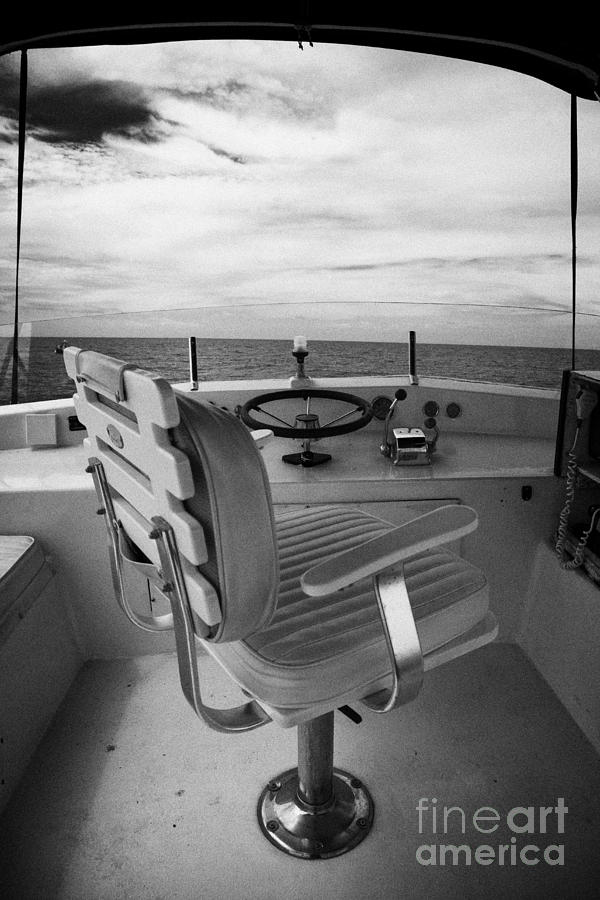 Charter Photograph - Controls On The Flybridge Deck Of A Charter Fishing Boat In The Gulf Of Mexico by Joe Fox