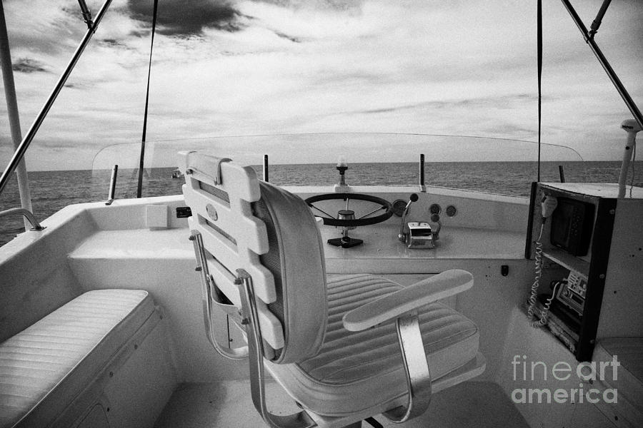Charter Photograph - Controls On The Flybridge Deck Of A Charter Fishing Boat In The Gulf Of Mexico Out Of Key West by Joe Fox