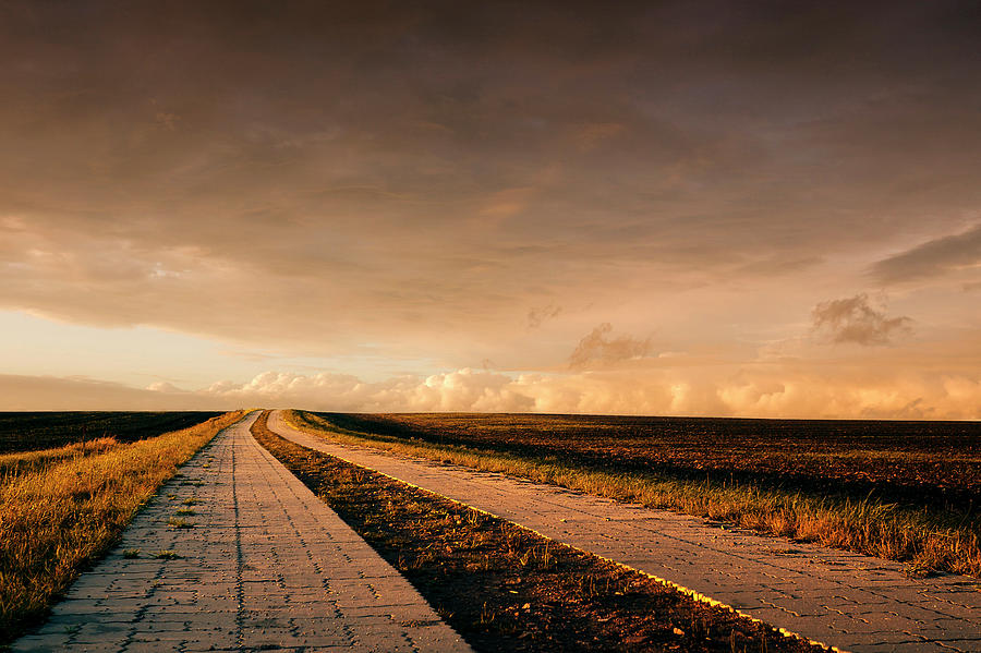 Country Lane Leading To The Horizon Photograph by Bernd Schunack