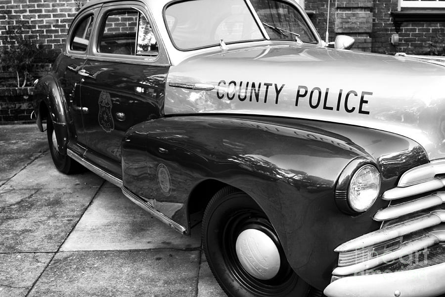 Police Car Photograph - County Police In Black And White by John Rizzuto
