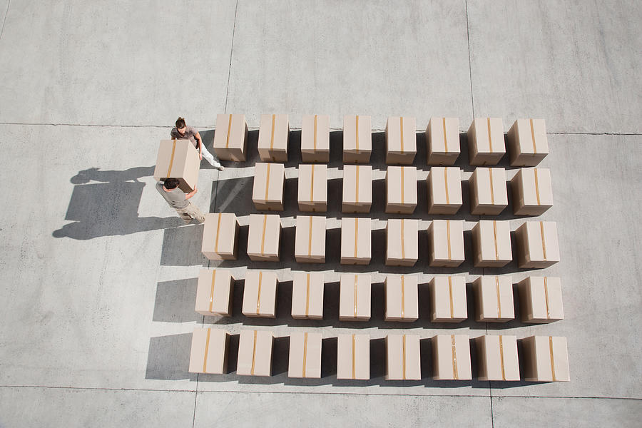 Couple carrying box Photograph by Martin Barraud