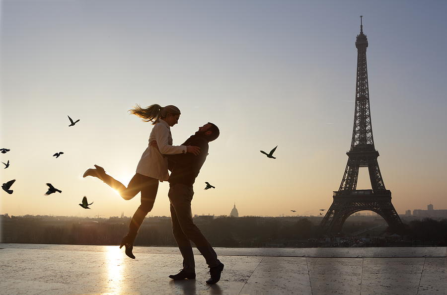 Couple Embracing, View Of Eiffel Tower Photograph by Peter Cade