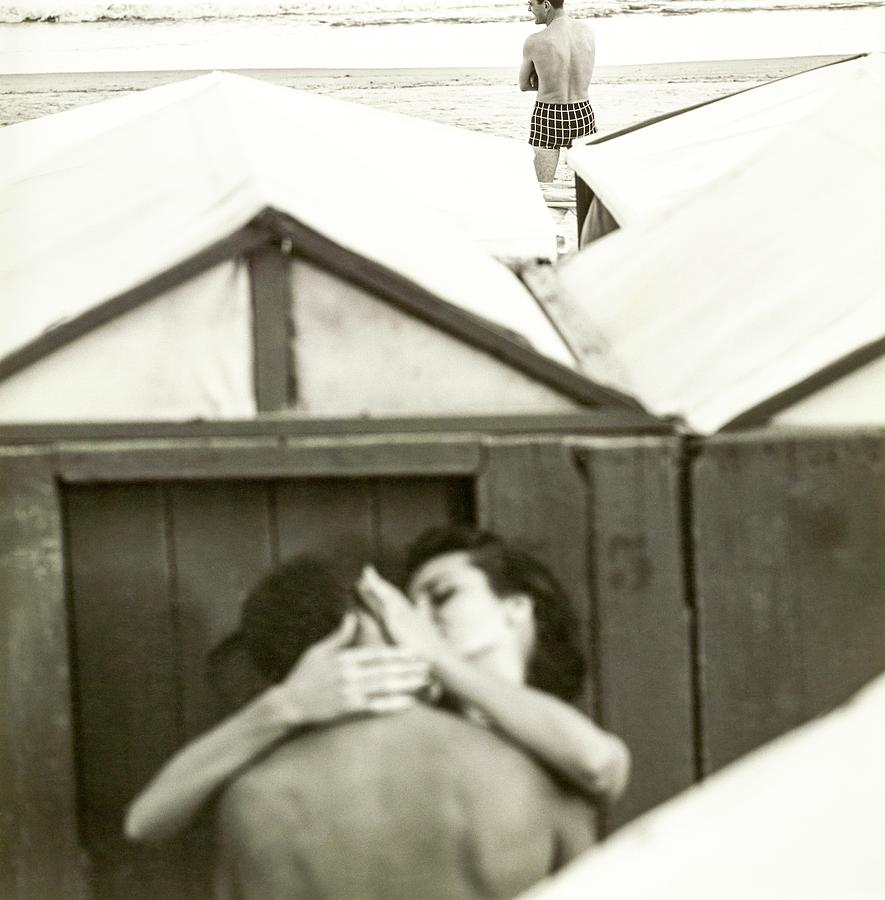 Couple Kissing By A Model Wearing Westwood Trunks Photograph by Chadwick Hall