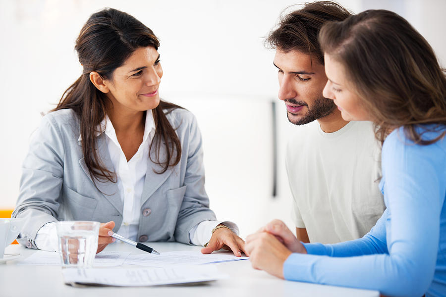Couple meeting with financial advisor Photograph by Skynesher