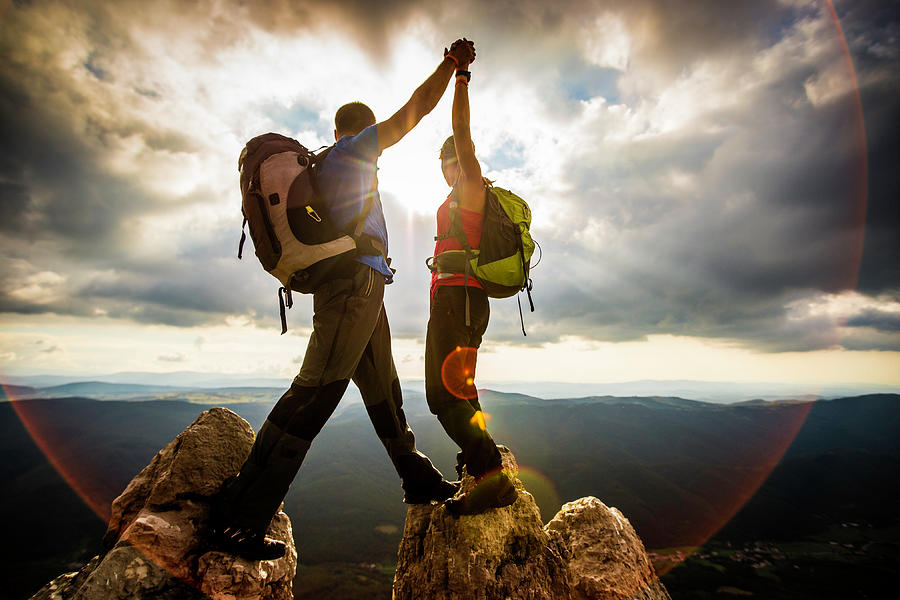 Couple On Top Of A Mountain Shaking Photograph by Vm