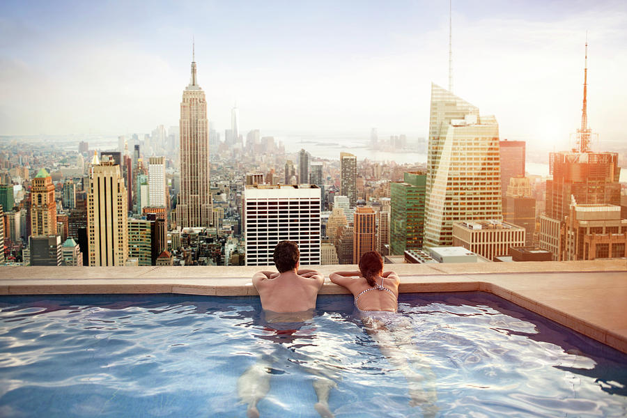 Couple Relaxing On Hotel Rooftop Photograph by Orbon Alija