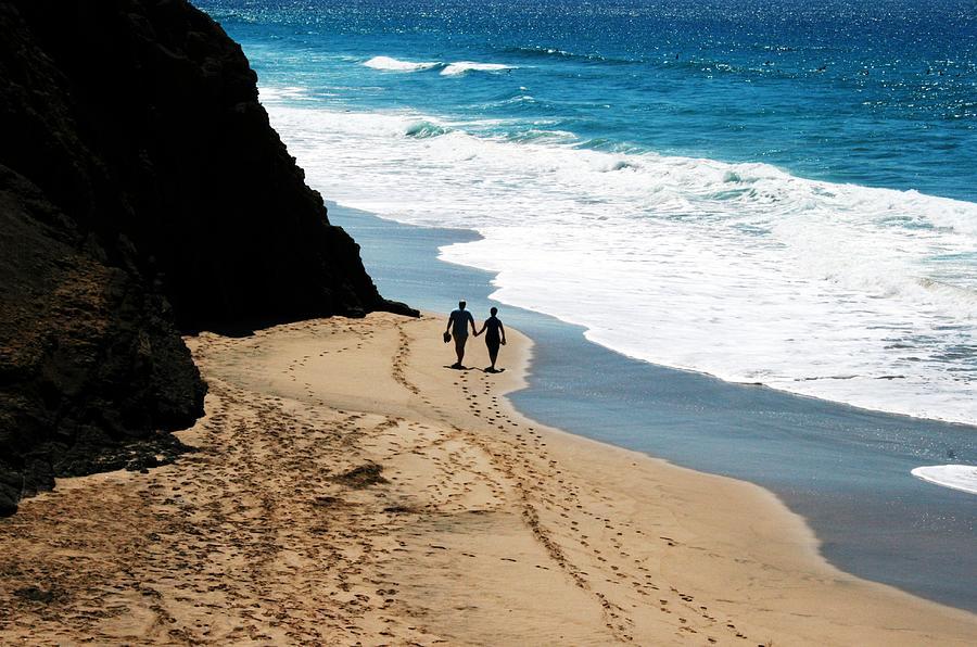 Couple Walking In Fuerteventura Beach Photograph by © Nico Piotto