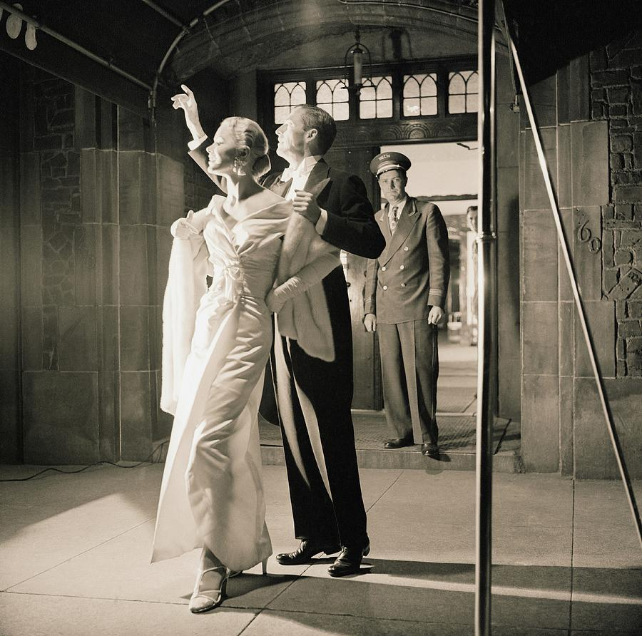 Couple Wearing Evening Wear Photograph by Horst P. Horst