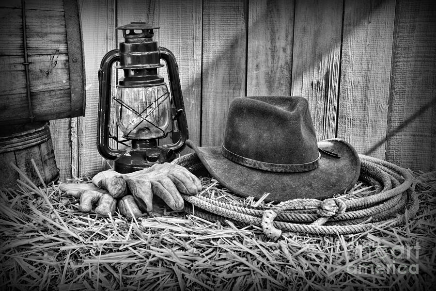 cowboy hat and rodeo lasso in a black and white photograph