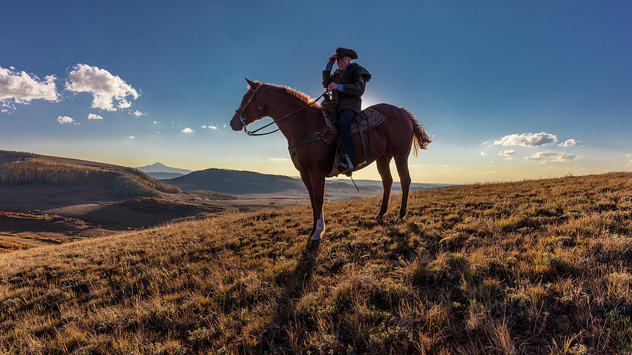 Horizontal Photograph - Cowboy Looks Out Over Historic Last by Panoramic Images