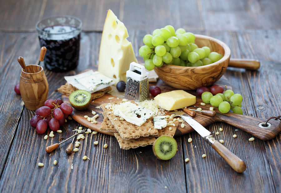 Crackers With Cheese And Fruits Photograph by Julia Khusainova