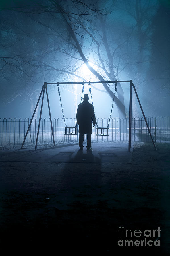Creepy Man Standing In A Children S Play Area At Night