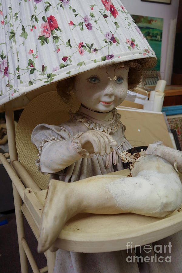 Creepy Old Doll With Broken Leg In A High Chair With A