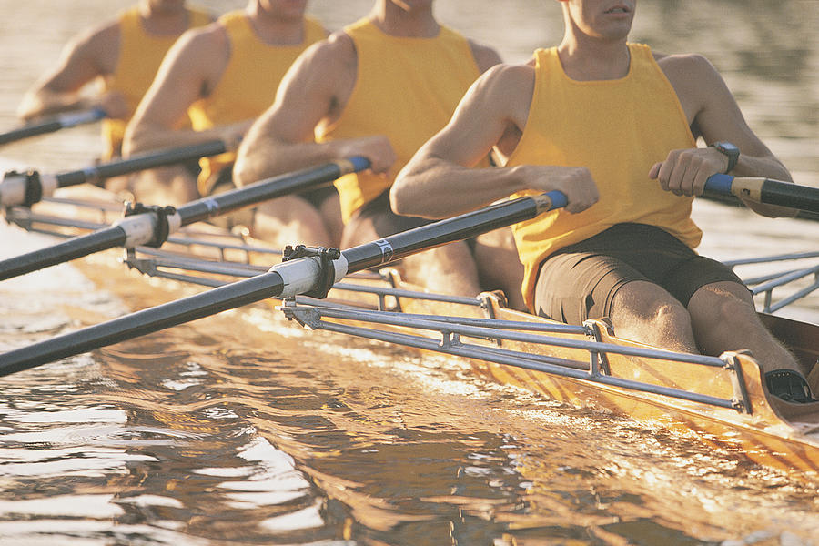 Crew team rowing a scull Photograph by Comstock