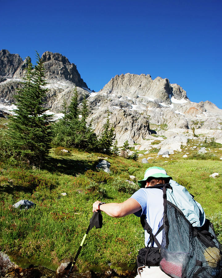 Active Photograph - Cropped Rear View Of A Female Hiker by Ron Koeberer