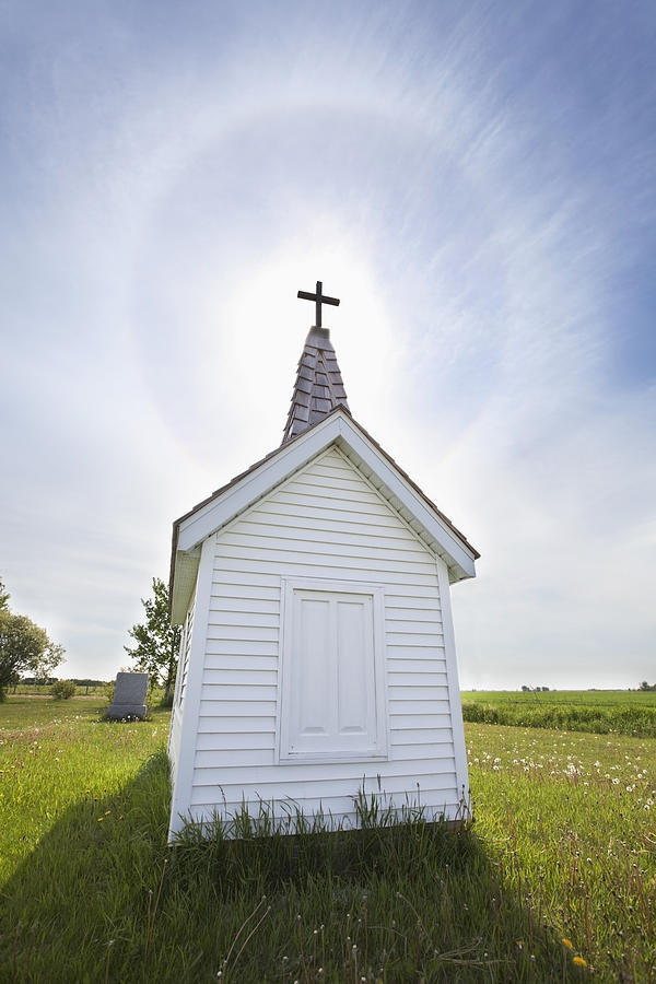 Building Photograph - Cross On Crypt With Sun Halo Near by Susan Dykstra
