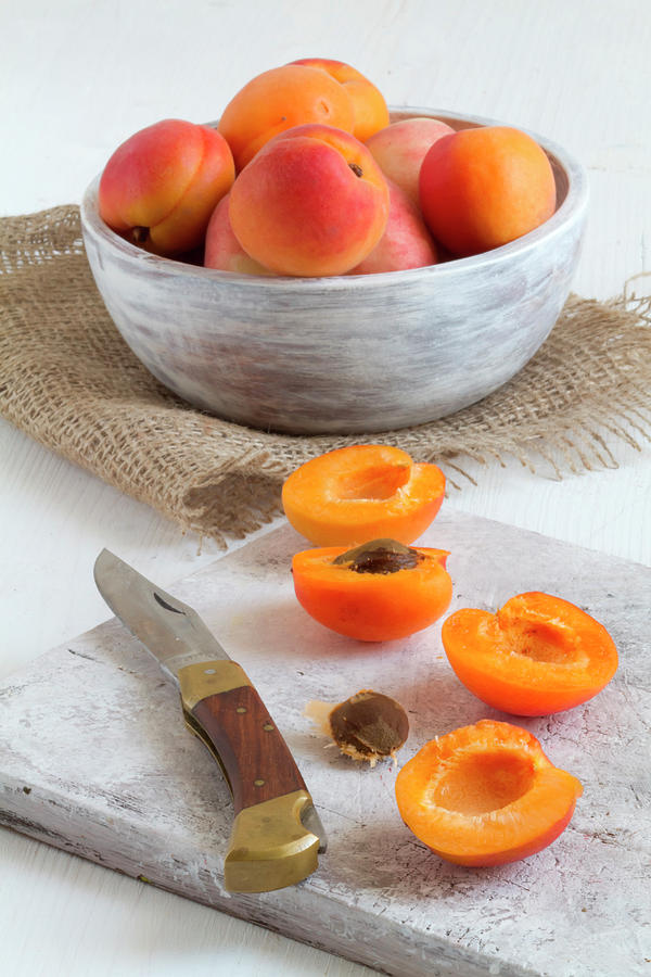 Cross Section Apricots With Knife And Photograph by Westend61
