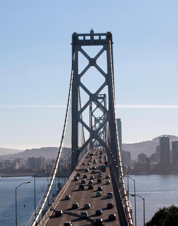 Treasure Island Photograph - Crossing The Bay Bridge  by Dee  Savage