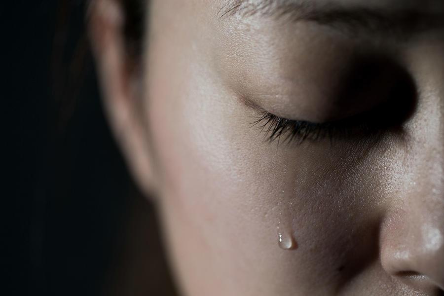 Crying young woman Photograph by Yuichiro Chino