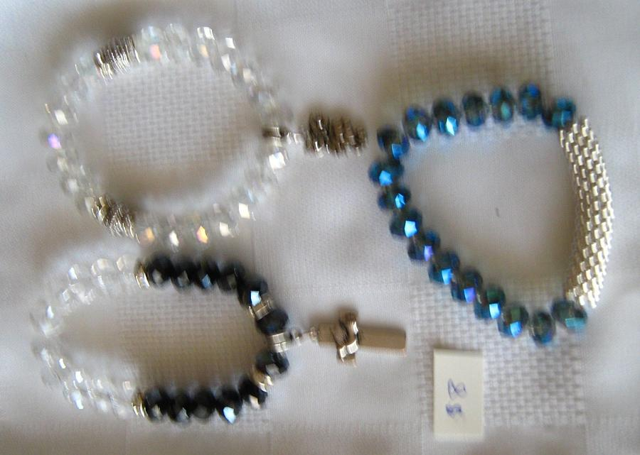 Handmade And Affordable Jewellery. Fits Comfortably Since It Is Made With Stretch Magic. Designs Are Unique. Support Your Local Toronto Artists. White Crystal Brace With Owl Jewelry - Crystal Bracelets -handmade by Fatima Pardhan