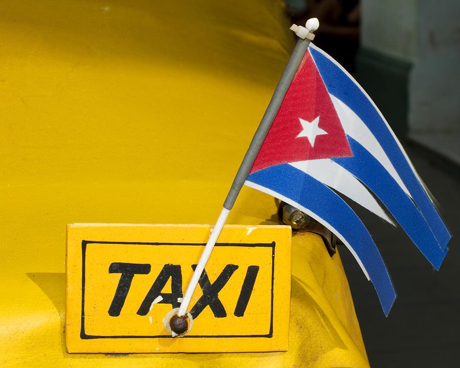 Cuba Photograph - Cuba Taxi by Norman Pogson