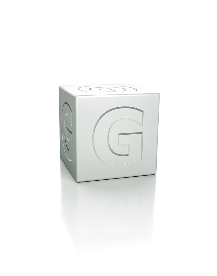 Artwork Photograph - Cube With The Letter G Embossed by David Parker/science Photo Library