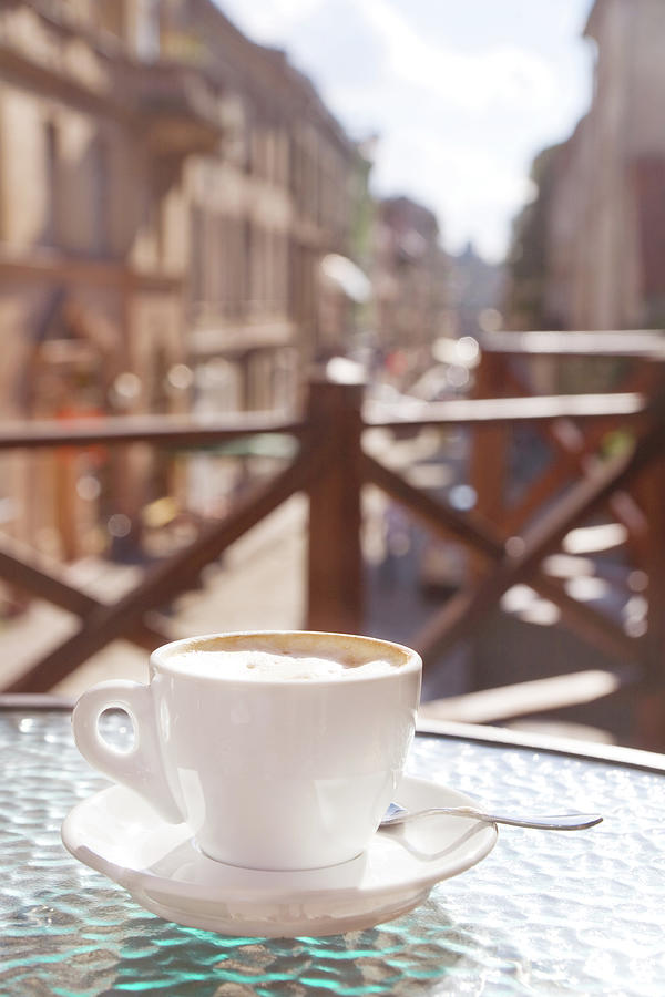 Cup Of Cappuccino In Outside Cafe Photograph by Mitshu