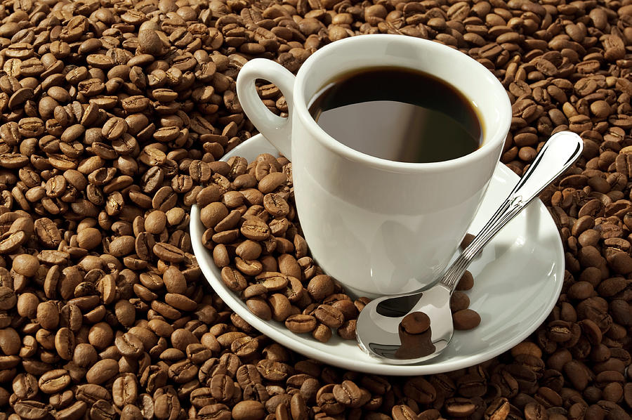 Cup Of Coffee And Beans Photograph by Ersinkisacik