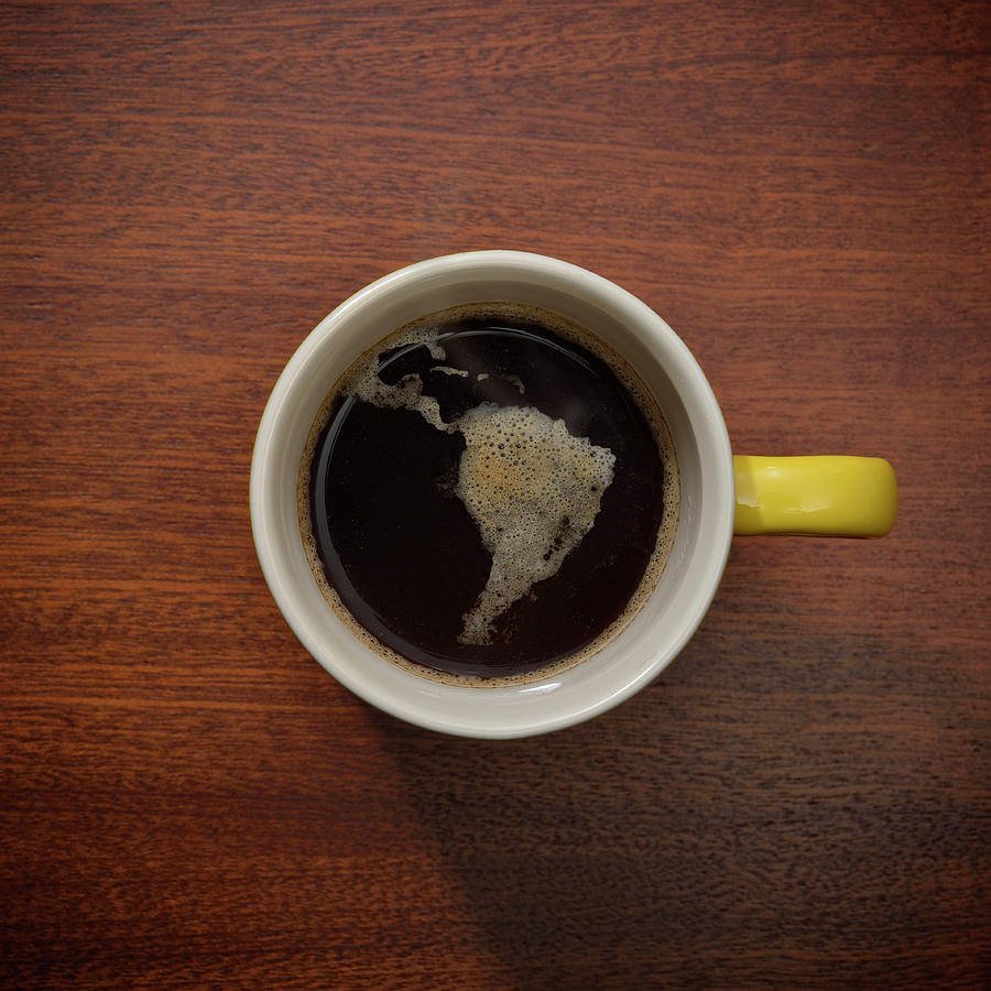 Cup Of Coffee With Crema Resembling Photograph by David Malan