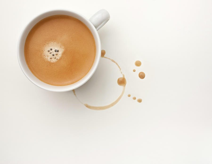 Cup Of Foaming Coffee And A Coffee Stain Photograph by Anthony Bradshaw