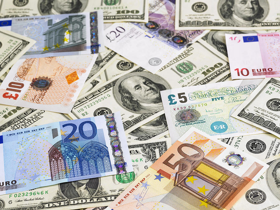 Currencies Photograph by Imagestock