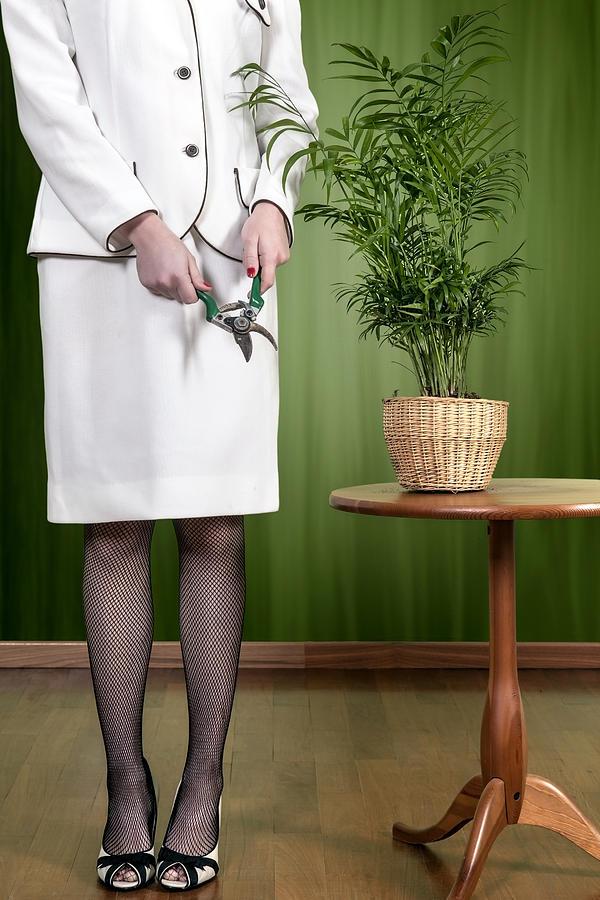 Woman Photograph - Cutting Plant by Joana Kruse