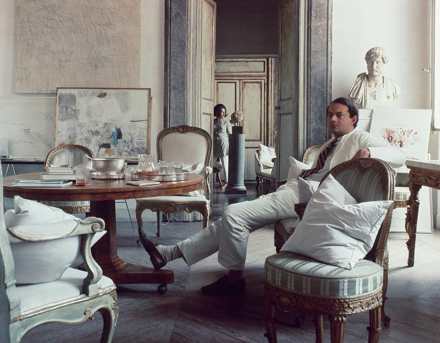 Cy Twombly Sitting In His Apartment Photograph by Horst P. Horst